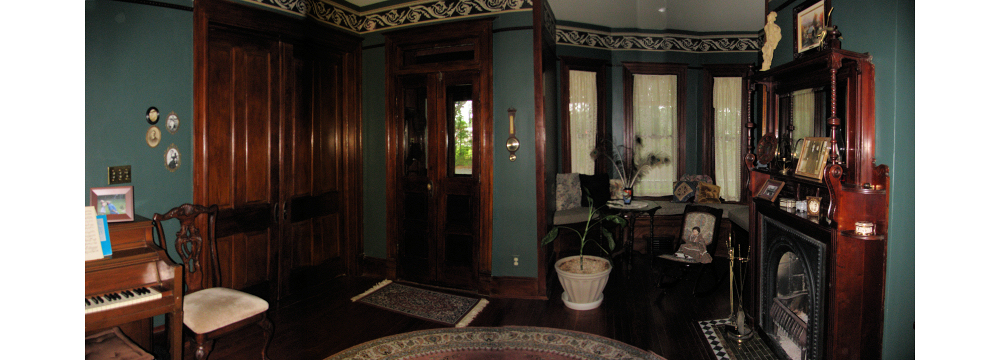 dark wood finish on doors, floor, and trim with walls painted dark green